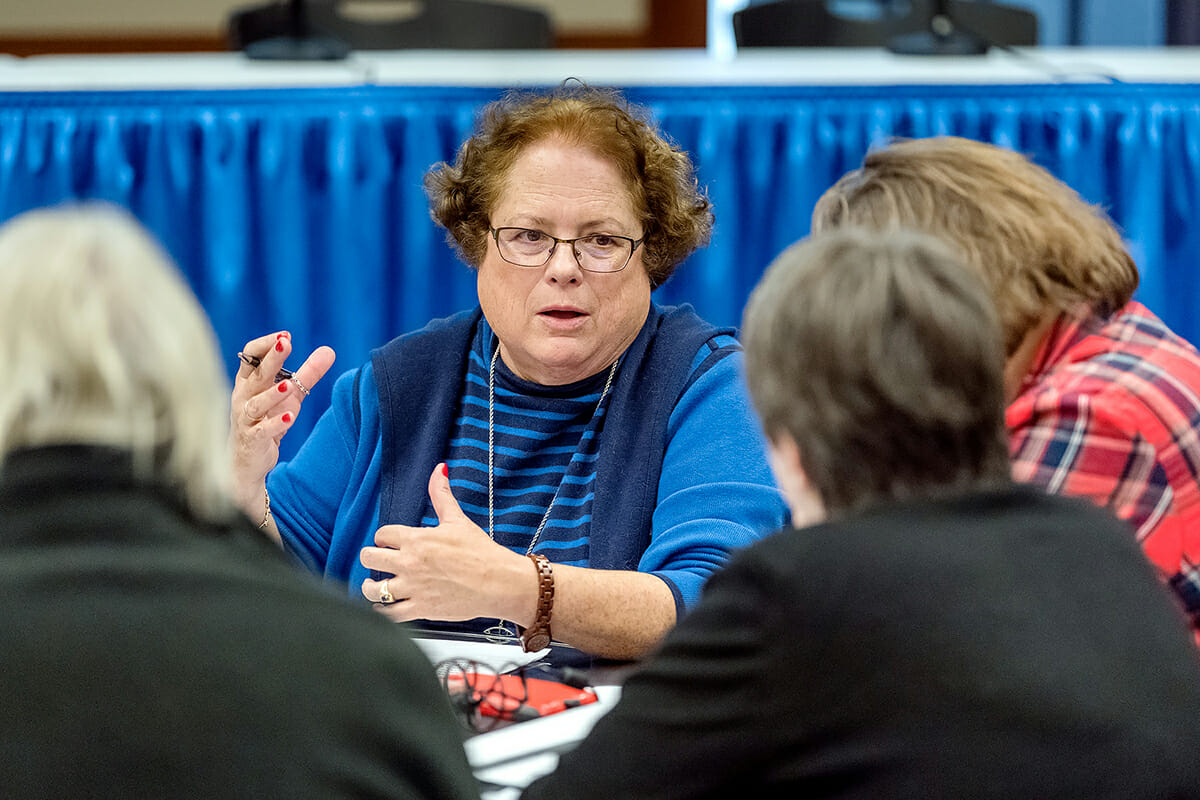 MTSU math professor Mary Martin, center, and other participants at the recent Texas Instruments-sponsored Leadership Summit discuss STEM-related questions during the networking event held in MTSU's Ingram Building MT Center. (MTSU photo by J. Intintoli)