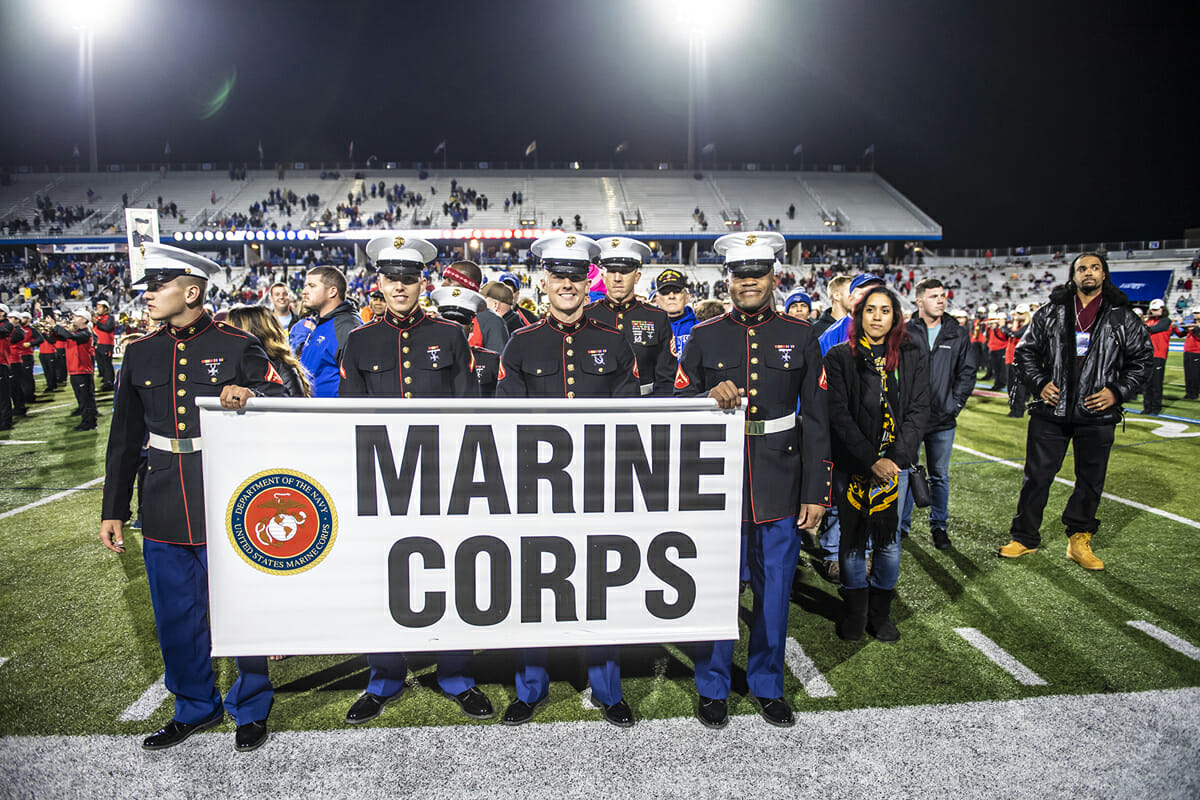 A group of U.S. Marine Corps active-duty personnel and veterans walked across Horace Jones Field in Floyd Stadium during the 37th annual Salute to Veterans and Armed Forces in November 2018. The halftime salute was part of saluting vets for their service with numerous activities. (MTSU file photo by Eric Sutton)