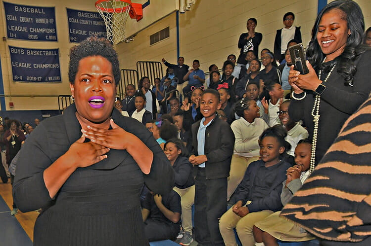 MTSU alumna Erica Stephens (Class of '02) is shocked as she is announced at an all-school assembly as a winner of the prestigious Milken Educator Award, a national honor that comes with a $25,000 financial prize. Stephens is a fourth-grade math teacher at John P. Freeman Optional School in Memphis, Tenn. (Photo courtesy of the Milken Family Foundation)