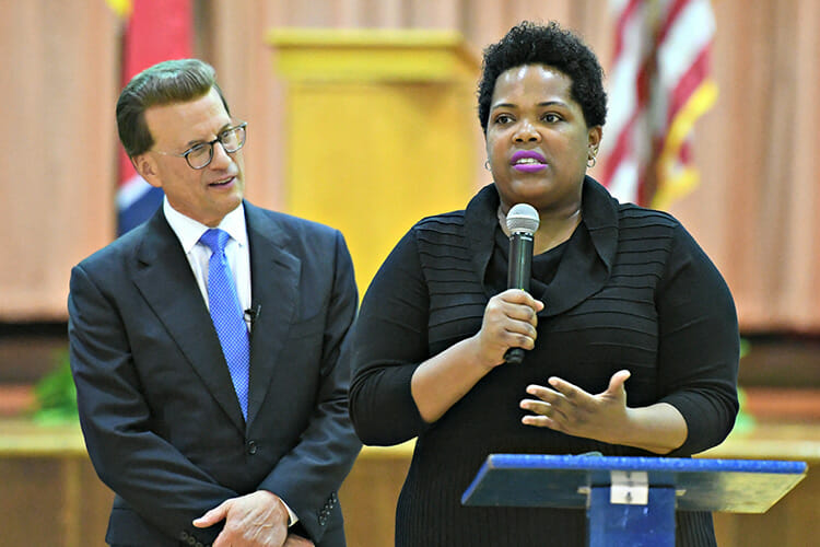 MTSU alumna Erica Stephens (Class of '02) speaks to an all-school assembly after she was announced as a winner of the prestigious Milken Educator Award, a national honor that comes with a $25,000 financial prize. Stephens is a fourth-grade math teacher at John P. Freeman Optional School in Memphis, Tenn. At left is Milken Family Foundation Chairman and co-Founder Lowell Milken. (Photo courtesy of the Milken Family Foundation)