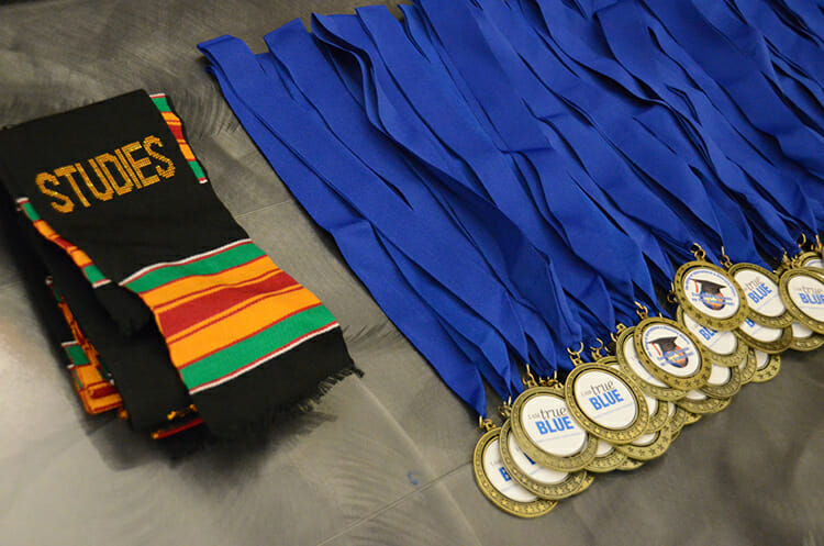 These special kente cloth stoles and True Blue medallions were presented during the 2018 Intercultural Graduation Reception held Nov. 19 inside the Student Union Ballroom. (MTSU photo by Jimmy Hart)