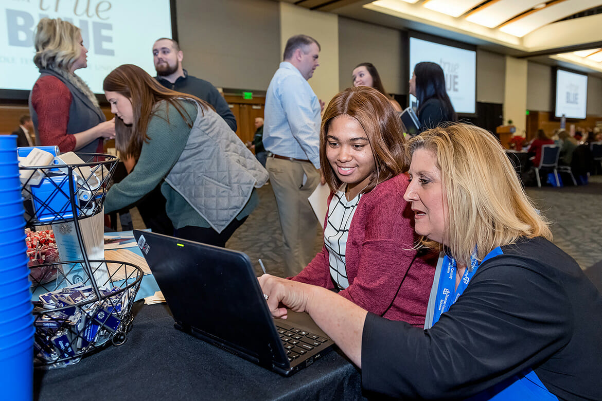 MTSU student teacher Kiara Richardson is assisted by Sumner County Schools recruiter Marla Pike during the MTSU College of Education's Student Teacher Seminar and Recruitment Fair held Wednesday, Dec. 12, in the Student Union Ballroom. Employers from across the region and as far as China came to meet with graduating student teachers. (MTSU photo by J. Intintoli)