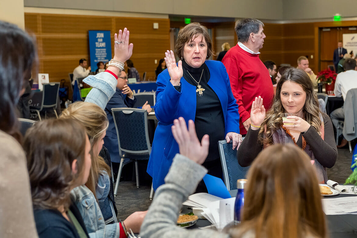 Lana Seivers, center, dean of the MTSU College of Education, talks to a group of Early Childhood Education students at the MTSU College of Education's Student Teacher Seminar and Recruitment Fair held Wednesday, Dec. 12, in the Student Union Ballroom. Employers from across the region and as far as China came to meet with graduating student teachers. (MTSU photo by J. Intintoli)