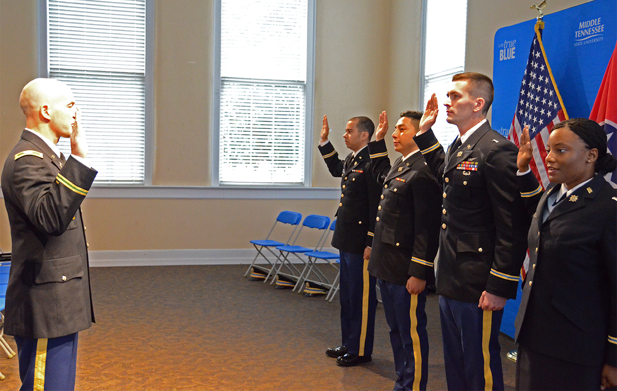 MTSU recent graduates take the Army oath as they are commissioned.