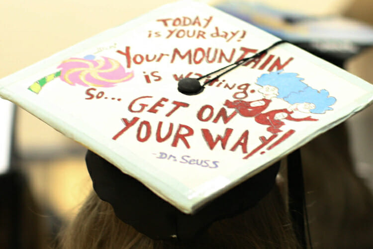 "An MTSU fall 2018 graduate celebrates earning her degree Saturday, Dec. 15, by decorating her mortarboard with an excerpt from Dr. Seuss' book ""Oh, The Places You'll Go!"" and illustrations from two of his other works. MTSU presented 1,731 degrees to students in dual ceremonies, including 1,471 undergraduates and 260 graduate students in the celebrations. (MTSU photo by GradImages.com)"