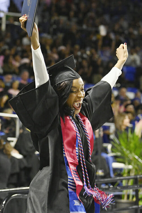 An MTSU student's exuberance and relief combine into a shout of joy as she holds her diploma aloft in Murphy Center Saturday, Dec. 15, during the university's fall 2018 afternoon commencement ceremony. MTSU presented 1,731 degrees to students in dual ceremonies, including 1,471 undergraduates and 260 graduate students in the celebrations. (MTSU photo by Andy Heidt)