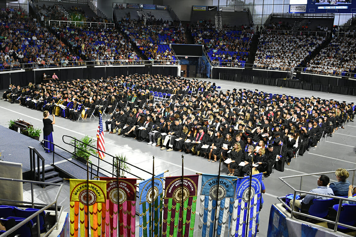 Students wait for the summer 2018 graduation ceremony to begin inside Murphy Center in this August file photo. MTSU's fall 2018 commencement ceremonies are set for 9 a.m. and 1:30 p.m. Saturday, Dec. 15. (MTSU file photo by GradImages.com)