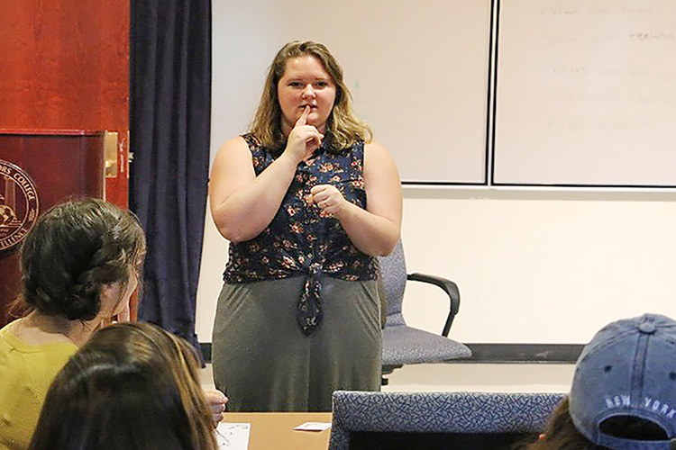 American Sign Language instructor Haley Jensen offers some ASL instruction in a fall 2018 class offered by MTSU's Center for Accelerated Language Acquisition as students watch and listen. CALA is offering an ASL Part 1 and Part 2 course this spring. (Photo by Enrique Geronimo/MTSU Sidelines)