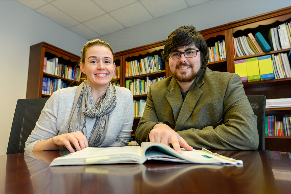 MTSU junior Scott Austin, right, shares a reading experience with Jennifer Flipse, director of the Tennessee Center for the Study and Treatment of Dyslexia. The center helped Austin learn strategies for dealing with dyslexia so that he could graduate from high school and attend college. (MTSU photo by J. Intintoli)