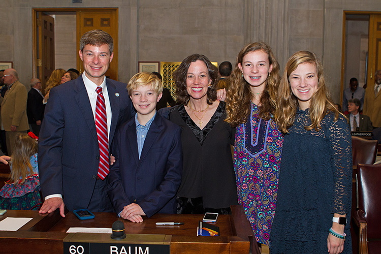 Charles Baum, left, a professor in the Jones College of Business, MTSU, was sworn in Tuesday, Jan. 8, as a state representative for Murfreesboro's 37th District. Pictured with him, from left, at the state Capitol in Nashville, are son Charles, wife Kelly, and daughters, Anna Jane and Elizabeth. (MTSU photo by James Cessna)