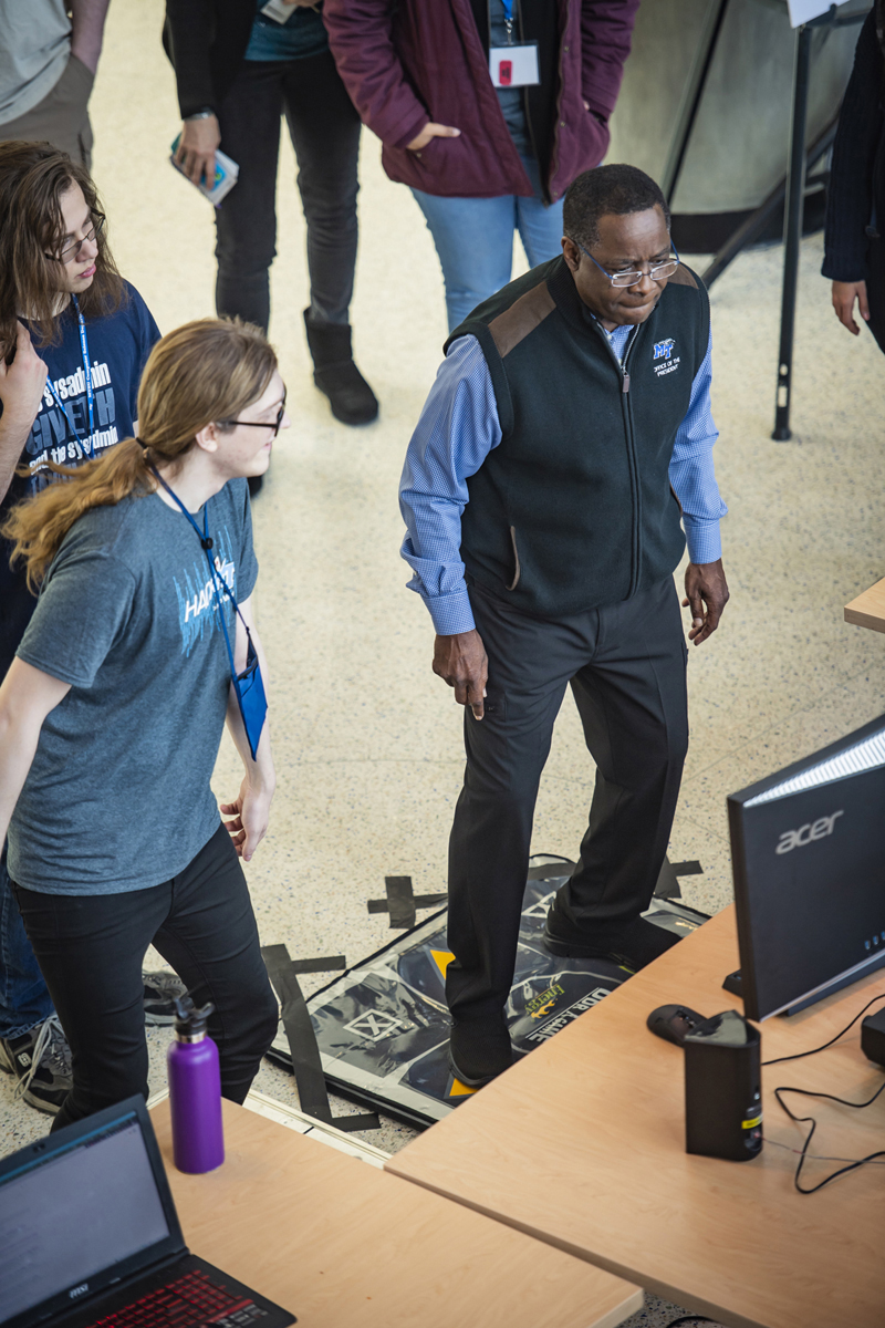 "MTSU President Sidney A. McPhee participants in Hack MT ""Breakdown Game"" challenge."