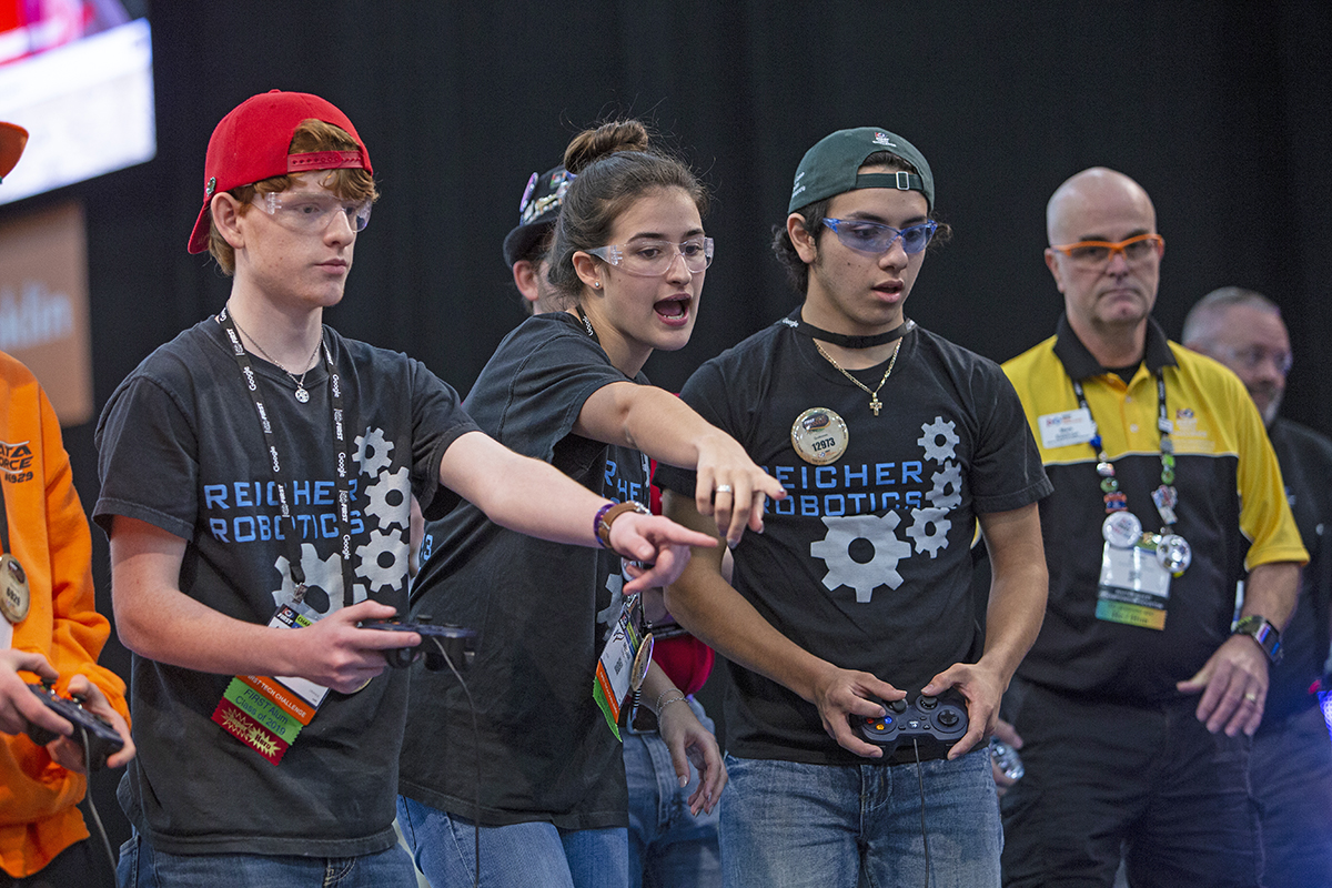 A team competes during a match at a FIRST Robotics competition.