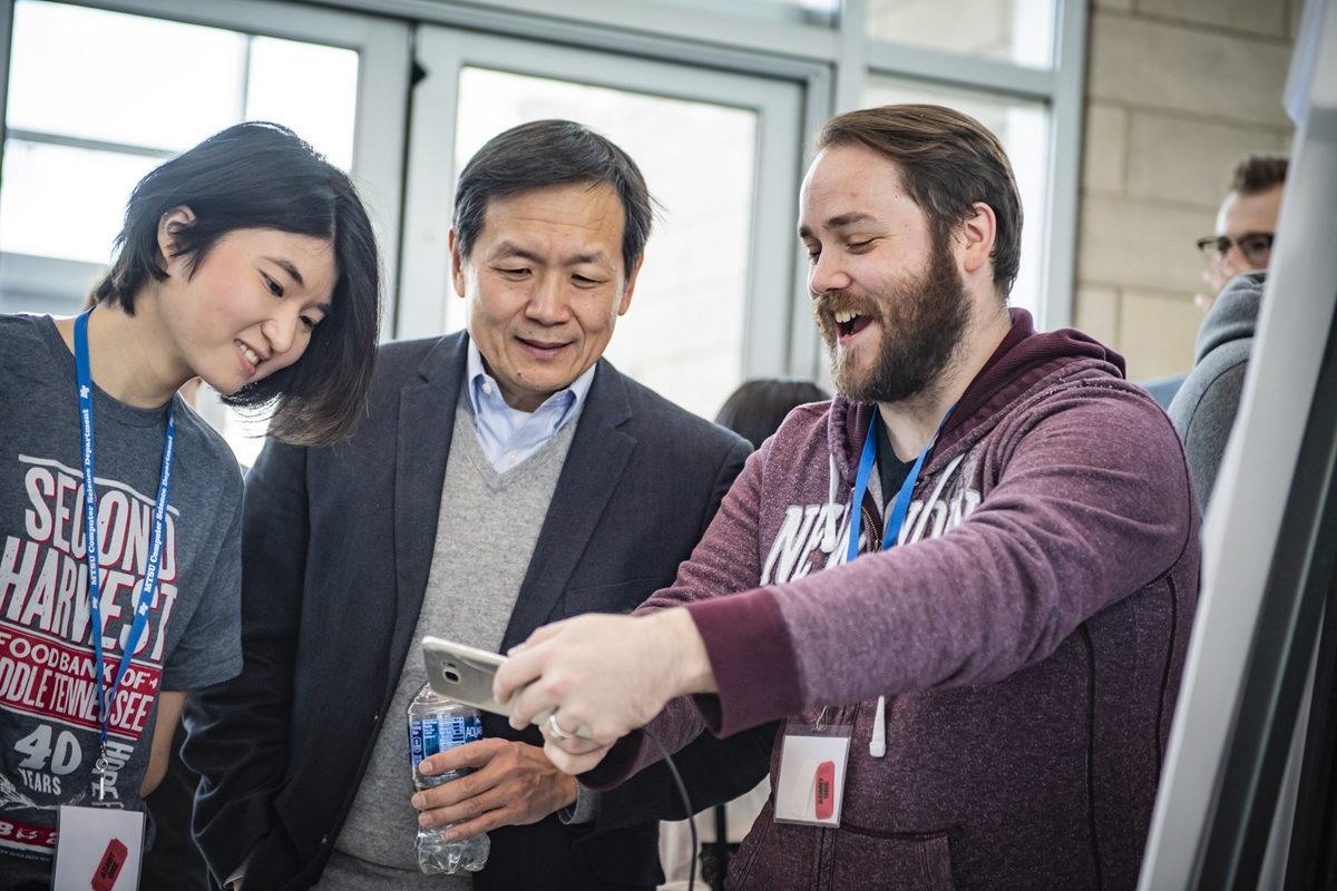 An MTSU senior at the time, Thomas Scott, right, demonstrates his group's augmented reality application to other attendees during the fourth annual Hack MT in January 2019 in the Science Building. This year's hackathon will take place Jan. 24-26 in the Science Building. (MTSU file photo by Kimi Conro)