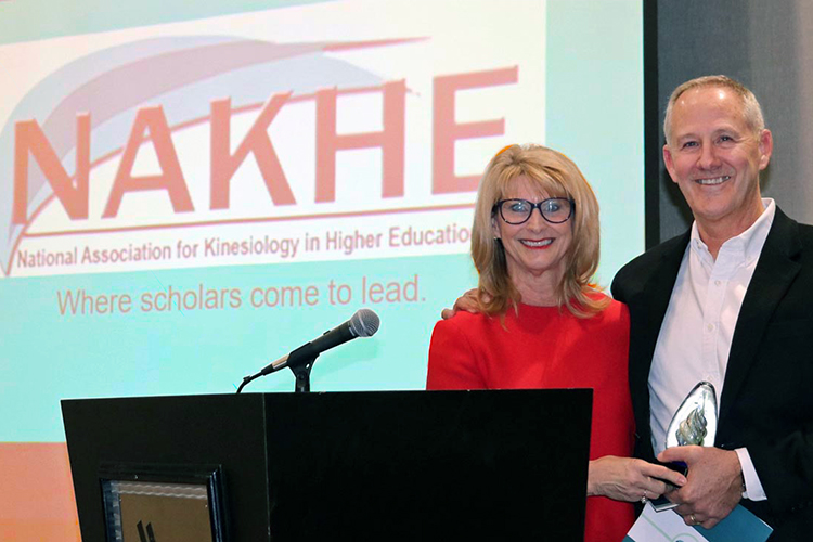 Dr. Steven Estes, right, a professor in MTSU's Department of Health and Human Performance and director of the department's Leisure and Sport Management Graduate Program, accepts the President's Award from National Association for Kinesiology in Higher Education President Betty Block of Texas A&M University at NAHKE's annual convention Jan. 10 in Savannah, Georgia. (Photo submitted)
