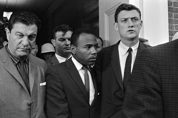 James Meredith, center, walks out of a building on the campus of the University of Mississippi, accompanied by U.S. marshals, in October 1962 after enrolling in the whites-only institution in Oxford to take classes and exercise his rights as a U.S. citizen. Meredith will serve as the keynote speaker for MTSU's 2019 Unity Luncheon, set Thursday, Feb. 14, in the Student Union Ballroom. (File photo by Marion S. Trikosko/Library of Congress)