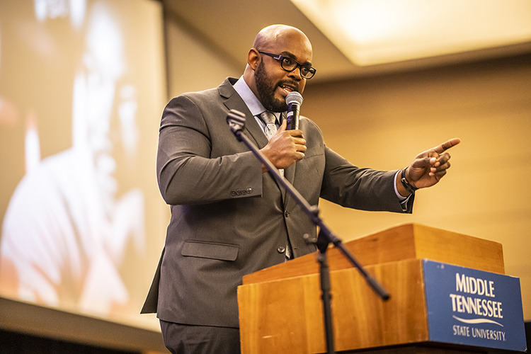 MTSU history professor Aaron Treadwell makes a point during keynote remarks at MTSU's 2019 MLK Candlelight Vigil honoring Dr. Martin Luther King Jr. The event was held Monday night inside the Student Union Ballroom. (MTSU photo by Eric Sutton)