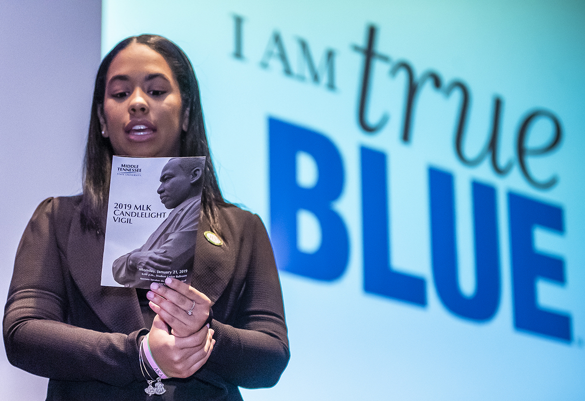 Alpha Kappa Alpha sorority member Cherilynn Mella, chapter vice president and co-emcee of MTSU's 2019 MLK Candlelight Vigil, recites the True Blue Pledge at the conclusion of the Jan. 21 event inside the Student Union Ballroom. (MTSU photo by Eric Sutton)