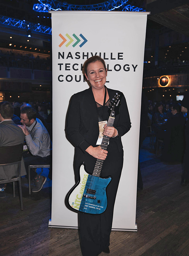 Amy Harris, associate professor in information systems and analytics at MTSU, holds the Nashville Technology Council's first Champion of the Year Award she received during the 10th annual awards ceremony held Jan. 24 at the Wildhorse Saloon in Nashville, Tenn. (Photo courtesy of the Nashville Technology Council)