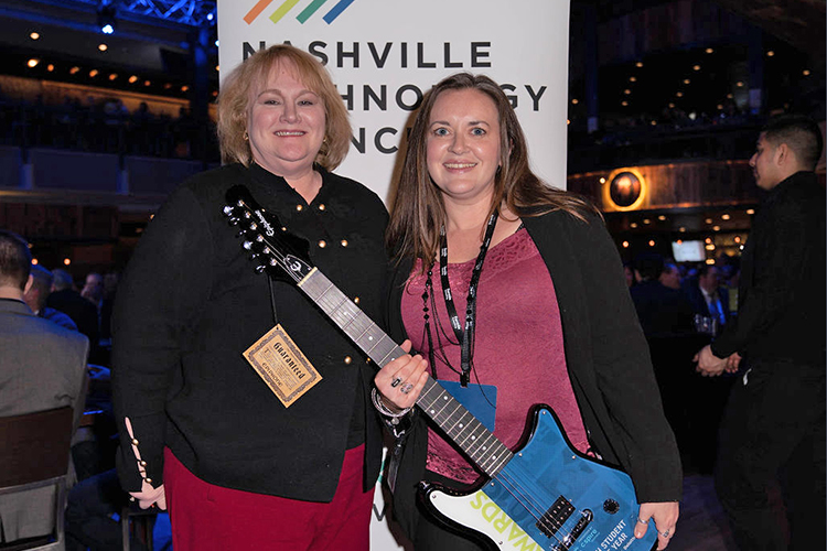 December 2018 Computer Information Systems and Analytics graduate Holly Yasui, right, holds the Nashville Technology Council's Student of the Year Award she received during the 10th annual awards ceremony held Jan. 24 at the Wildhorse Saloon in Nashville, Tenn. Pictured with her is Susan Lewis of Deloitte. (Photo courtesy of the Nashville Technology Council)