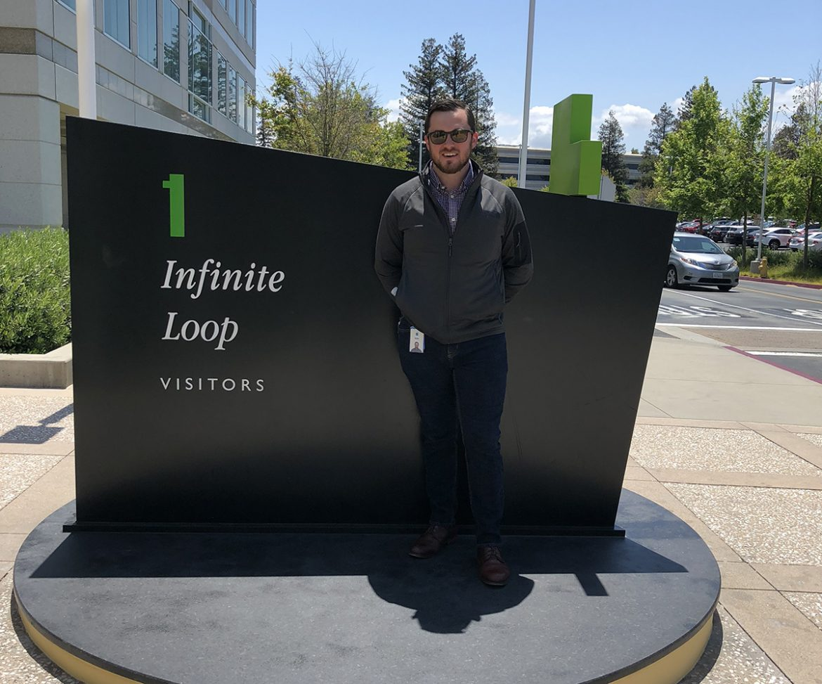 MTSU alum Blake Merryman ('13) standing in front of the visitor's entrance to Apple's Cupertino, CA campus.
