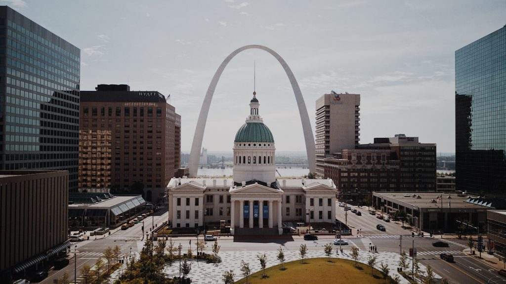 Photo of St. Louis downtown buildings and Arch in the background. Photo by Brittney Butler on Unsplash.com.