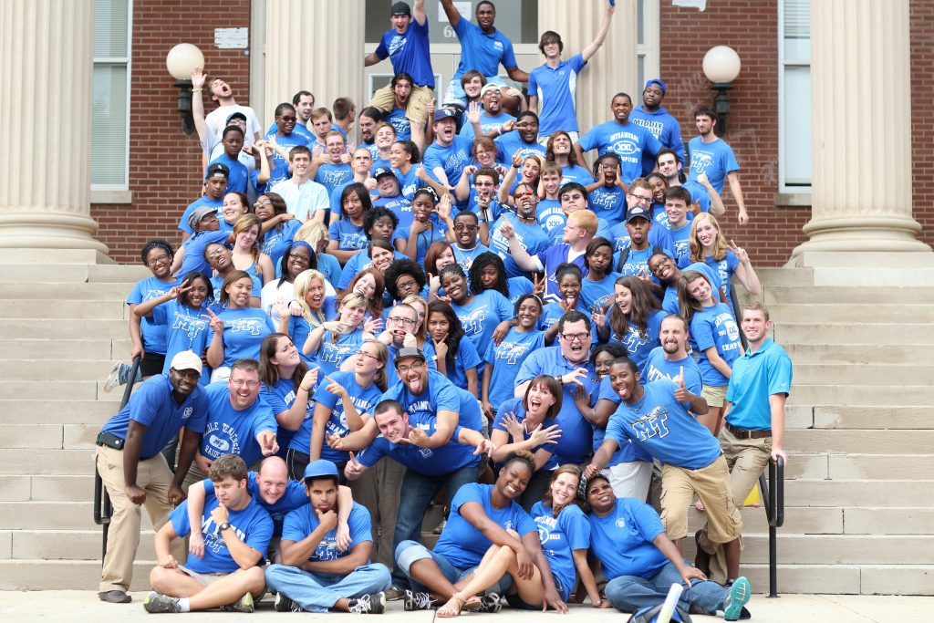 Blake and the rest of the housing staff during his time at MTSU standing on the steps of Kirksey Old Main.