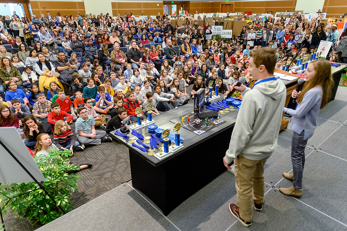 "New Jersey sibling inventor-entrepreneurs Joey, center left, and Heidi Hudicka encourage local fourth-, fifth- and sixth-graders attending MTSU's 27th annual Invention Convention, held Feb. 21 in the university's Student Union Ballroom, to ""make that leap"" to share their ideas with the world. Nearly 800 Midstate youngsters attended this year's event, displaying a total of 375 inventions and accompanied by their teachers, families and other supporters. (MTSU photo by J. Intintoli)"