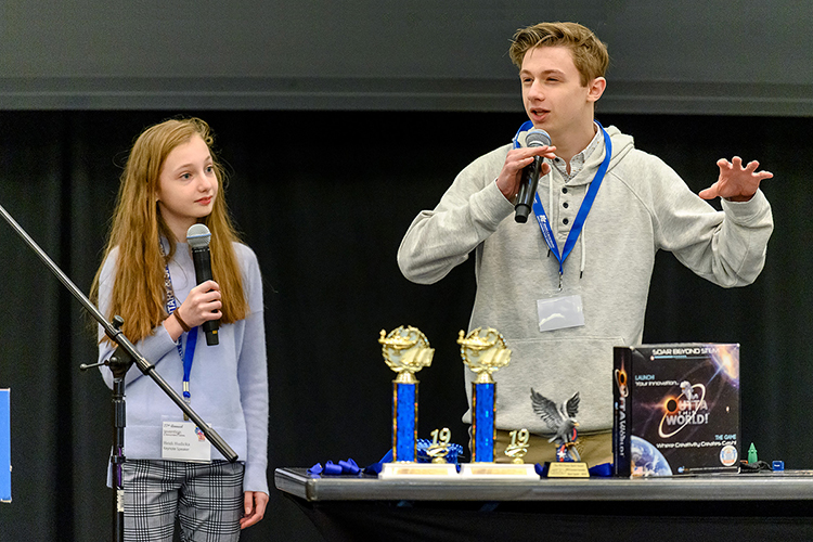 "New Jersey sibling inventor-entrepreneurs Heidi, left, and Joey Hudicka encourage local fourth-, fifth- and sixth-graders attending MTSU's 27th annual Invention Convention, held Feb. 21 in the university's Student Union Ballroom, to ""make that leap"" to share their ideas with the world. Nearly 800 Midstate youngsters attended this year's event, displaying a total of 375 inventions. (MTSU photo by J. Intintoli)"