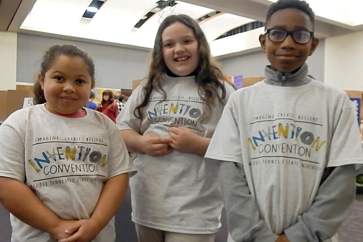 "A trio of innovators from Murfreesboro's Mitchell-Neilson Elementary School discuss their ""Keep Calm & Cool Basketball Game"" at MTSU's 27th annual Invention Convention, held Feb. 21 in the university's Student Union Ballroom. From left are fourth-grader Keeley Vaughn, fifth-grader Breanna Nolen and fourth-grader Malaki Frierson, who found their inspiration in sports and a special person in their lives. The three were among nearly 800 Midstate youngsters attending this year's event, displaying a total of 375 inventions. (MTSU photo by News and Media Relations)"