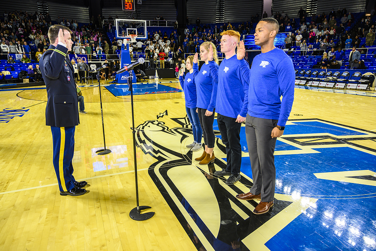 U.S. Army Lt. Col. Carrick McCarthy, left, chair of MTSU's Department of Military Science, administers the Army oath to four MTSU students who will become cadets in the program. Taking the oath are, from center left, new cadets Jordan Plumb, Kylee Harrison, Caleb Rowland and Ladarius Fitzgerald. (MTSU photo by Eric Sutton)