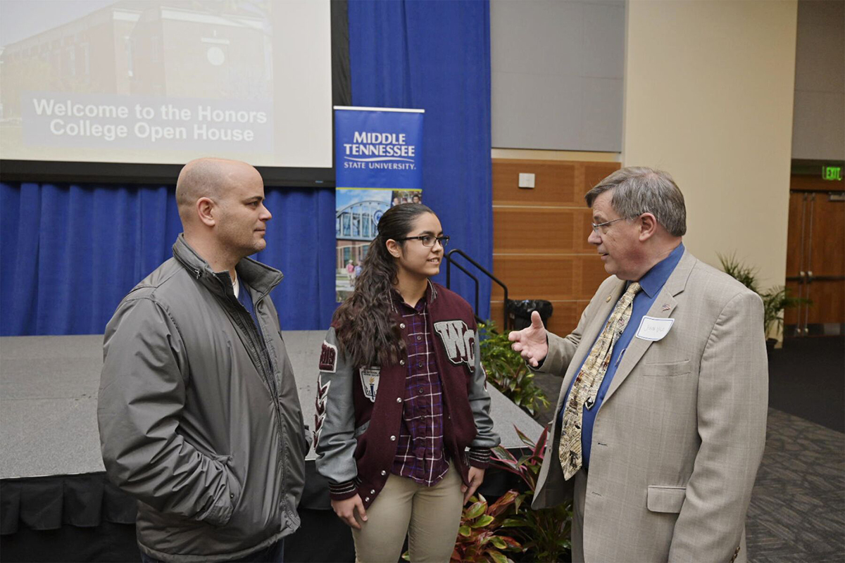 David Willequer, left, and his daughter, Ana Cannon, both of Clarksville, Tenn., listen as MTSU Dean John Vile shares about life in the University Honors College, which held an open house Feb. 18 for prospective students in the Student Union Ballroom and other campus venues. (MTSU photo by Andy Heidt)