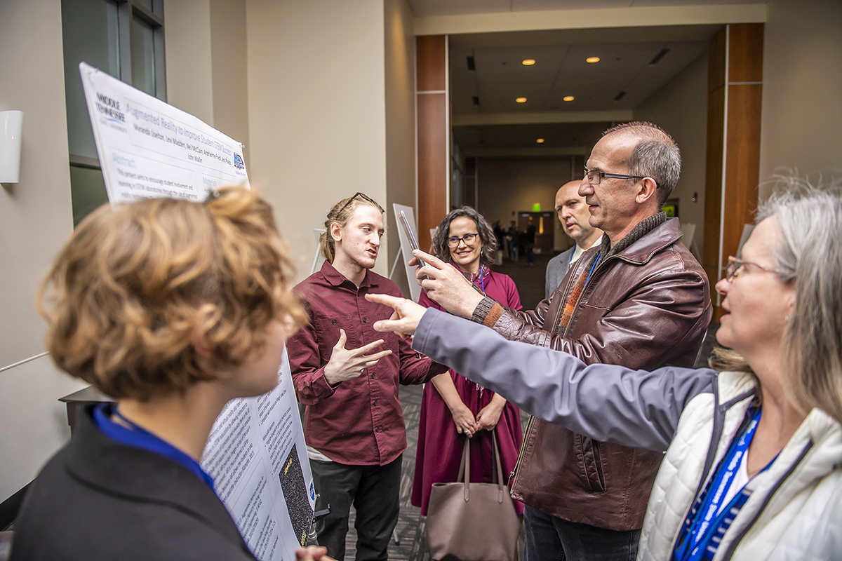Tennessee STEM Education Center conference attendees view a poster.