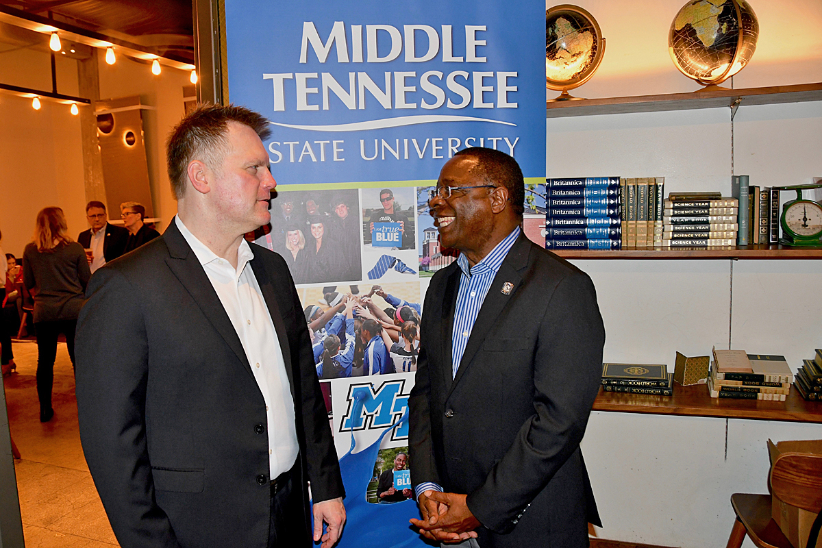 "MTSU President Sidney A. McPhee, left, chats with multiple Grammy award nominee and 2000 School of Music alumnus Wayne Haun, who is nominated again this year as part of the best roots gospel album category for producing ""Clear Skies"" by Ernie Haase & Signature Sound. (MTSU photo by Andrew Oppmann)"
