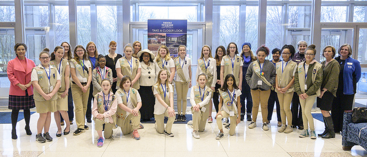 MTSU first lady Elizabeth McPhee, center left in white hat, is shown with a group of about 20 local Girl Scouts as well as some MTSU faculty and staff Tuesday inside the Cope Administration Building. The scouts met with various MTSU faculty and staff during a daylong career mentoring visit hosted by McPhee. (MTSU photo by Andy Heidt)
