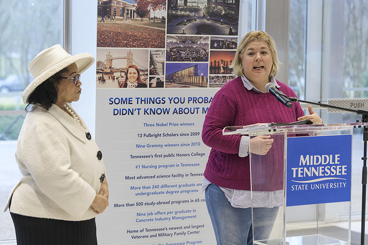 Dawn Rhodes, right, regional executive of membership for Girl Scouts of Middle Tennessee, thanks MTSU first lady Elizabeth McPhee, left, during remarks inside the Cope Administration Building Tuesday. McPhee hosted a daylong career mentoring visit for the group of about 20 scouts, who met with various university faculty and staff throughout the day. (MTSU photo by Andy Heidt)