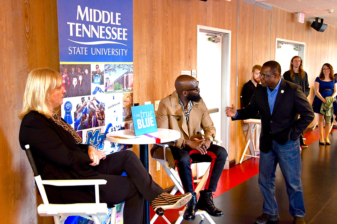 "President Sidney A. McPhee, right, congratulates MTSU alumnus and Grammy winner Torrance ""Street Symphony"" Esmond, who was honored Saturday, Feb. 9, by Middle Tennessee State University as part of its events before the Grammy Awards. At left is Beverly Keel, chair of the Department of Recording Industry. (MTSU photo by Andrew Oppmann)"