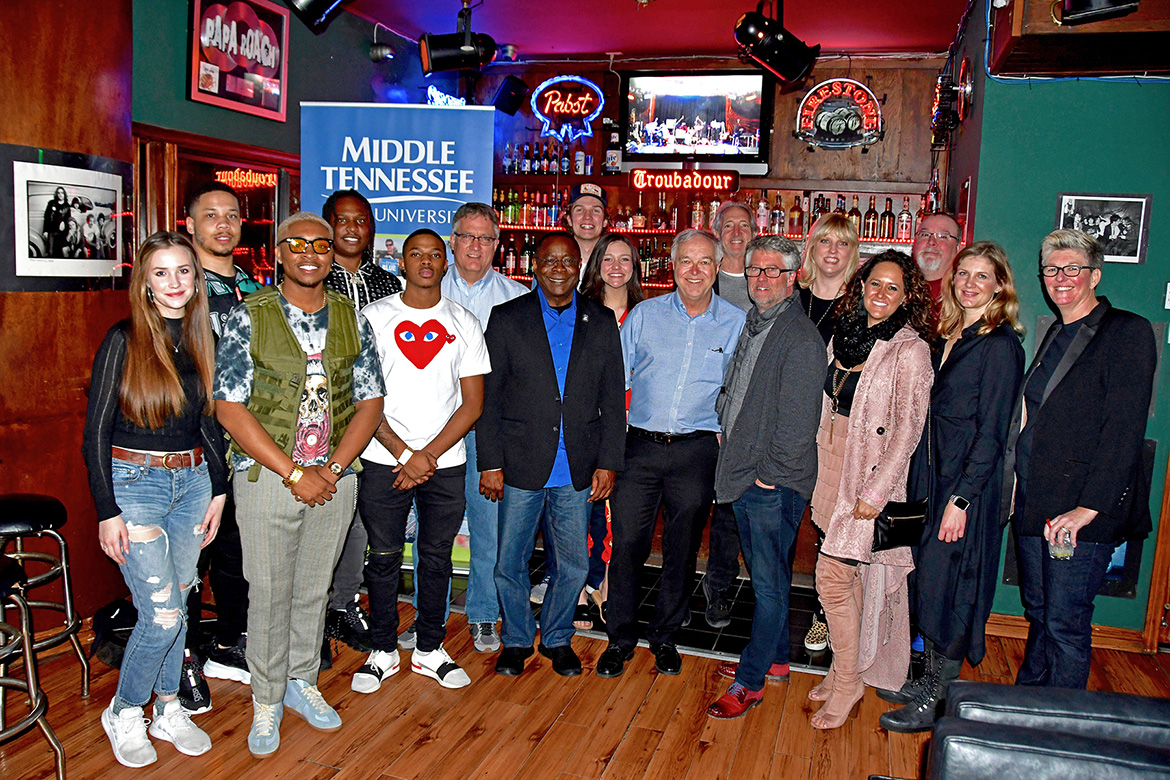 "Recent MTSU graduate and rising hip-hop music producer BryTavious ""Tay Keith"" Chambers, fourth from left, joins students and faculty from the MTSU College of Media and Entertainment at a reception Saturday night, Feb. 9, at the renowned Troubadour music venue. MTSU co-sponsored a tribute by the Americana Music Association of legendary artist John Prine. (MTSU photo by Andrew Oppmann)"