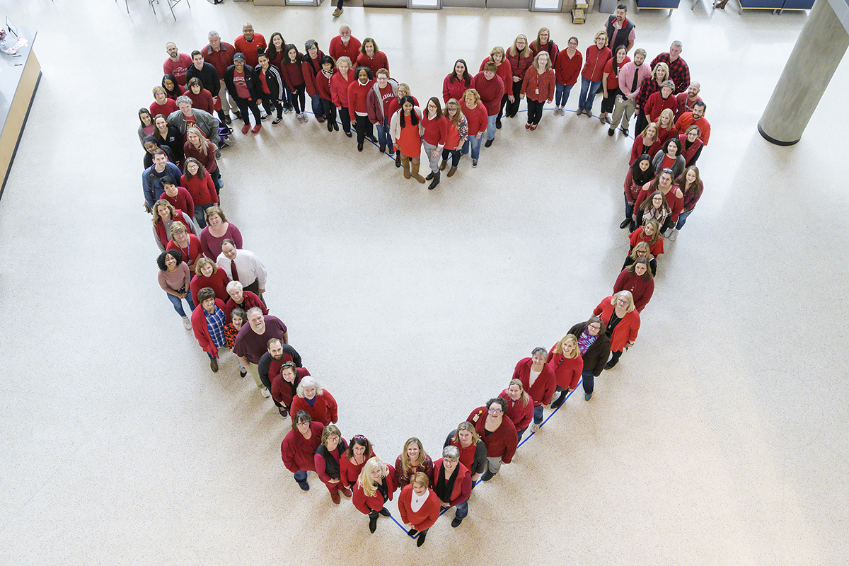 MTSU employees form a human heart.