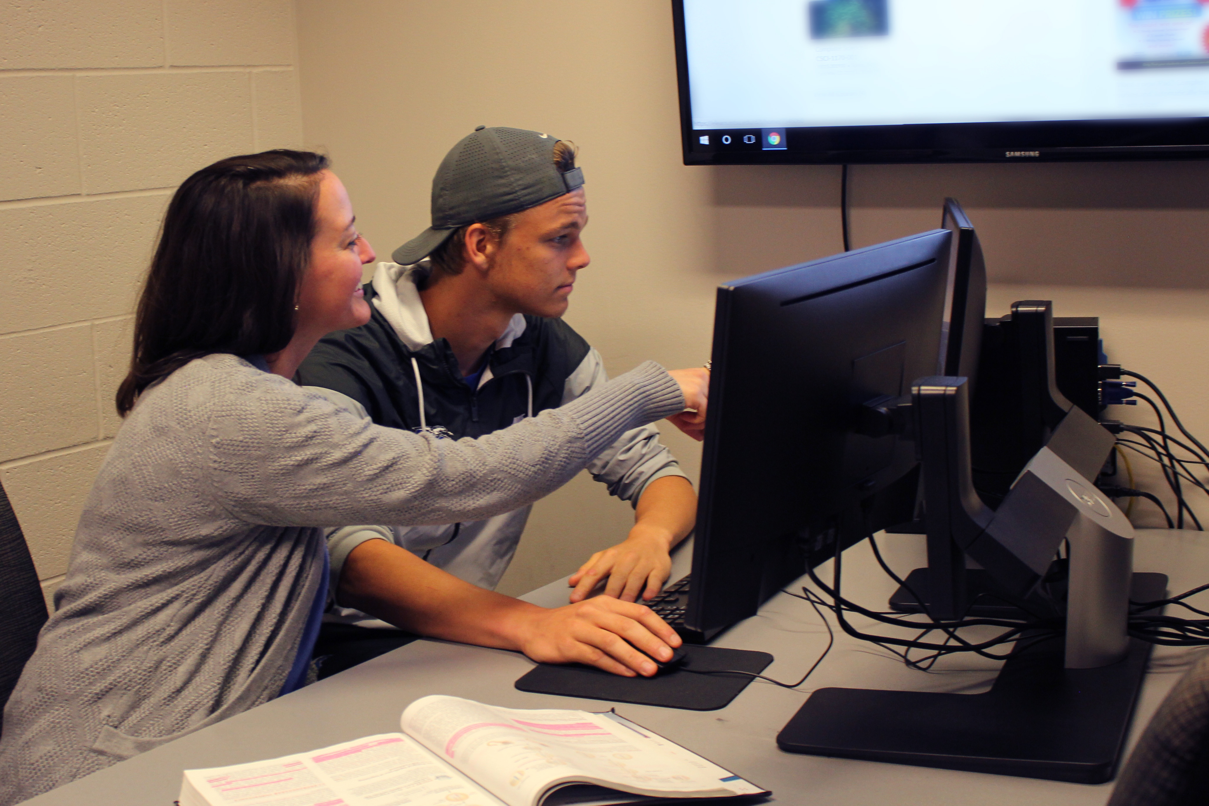 Madison Lowrance, a faculty member, tutors MTSU tennis player Stijn Slump, in Student-Athlete Enhancement Center