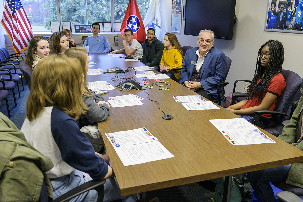 Roger Pieroni, second from right, chair in the MTSU Department of World Languages, Literatures and Cultures, listens as a Blackman High School junior shares about her interests and favorite subject.