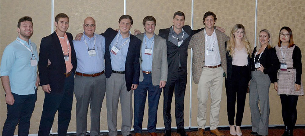 Members of MTSU's Blue Raider Real Estate Club and some of their fellow participants in the Fall 2018 Society of Industrial and Office Realtors Foundation Student Real Experience Program are joined by David Hagan, SIOR Foundation trustee and past president, for a photo at the SIOR fall conference held in October in Denver, Colo. Shown, from left, are MTSU students Cailen Roth and Daniel Vincent; the SIOR Foundation's Hagan; University of North Carolina at Chapel Hill students Mathis Nedell and Stanford Shell; University of Southern California student Pierce Schneider; MTSU student Heyward Rogers; Caci Rhuda, a student at the University of Connecticut School of Business; MTSU student Ashleigh Turner; and Lu Zhao, a student at the United Kingdom's University of Reading. (Photo courtesy of SIOR)