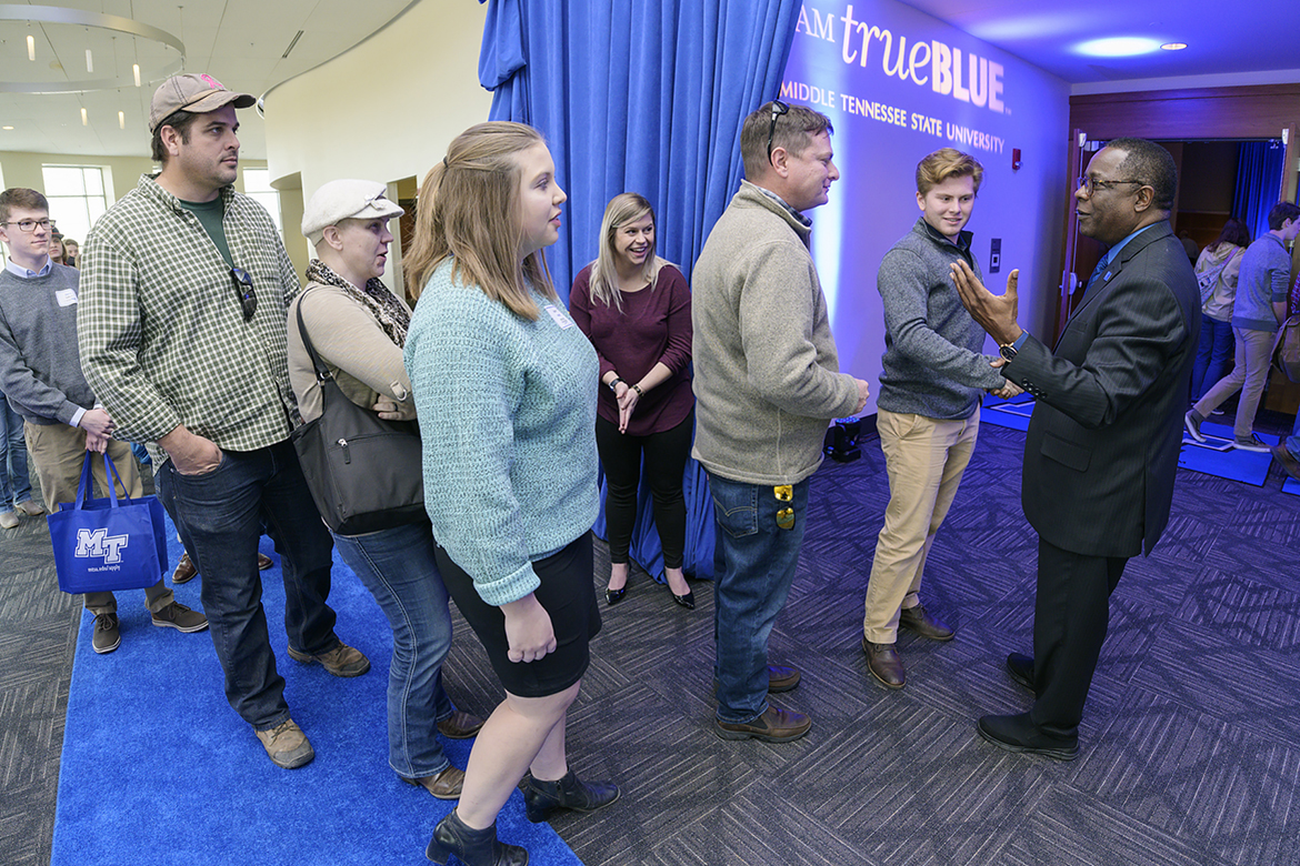 On the blue carpet outside the Student Union Ballroom, MTSU President Sidney A. McPhee, right, greets guests arriving for the Feb. 18 Celebration of Scholars event for prospective students who have been offered Trustee and Presidential Scholarships. (MTSU photo by Andy Heidt)
