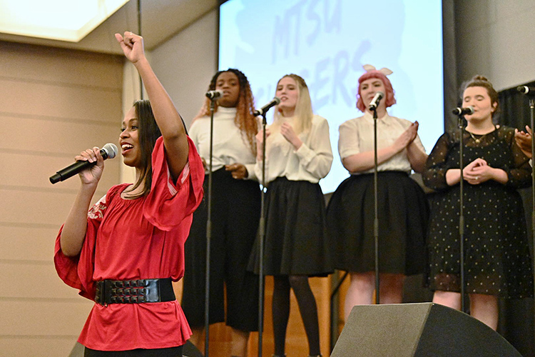 Ashley Kimbrough, adjunct professor of jazz voice, and members of the MTSU Vocal Jazz Ensemble perform at the 23rd MTSU Unity Luncheon Feb. 14. The ensemble is directed by music professor Cedric Dent (not pictured). (MTSU photo by J. Intintoli)