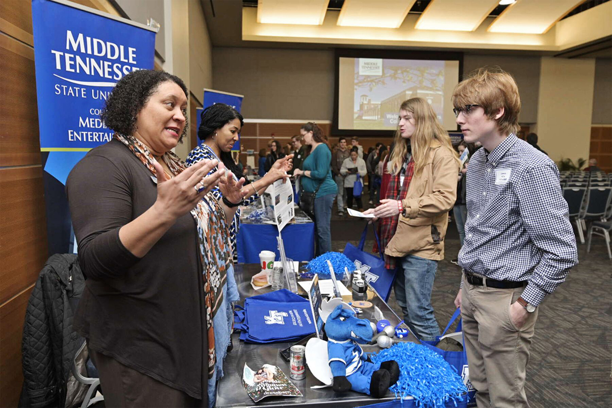 MTSU College of Media and Entertainment adviser Tiffany Milfort, left, shares information about her college with Lawson Hillis Feb. 18 during the annual Presidents Day Open House in the Student Union Ballroom. (MTSU photo by Andy Heidt)
