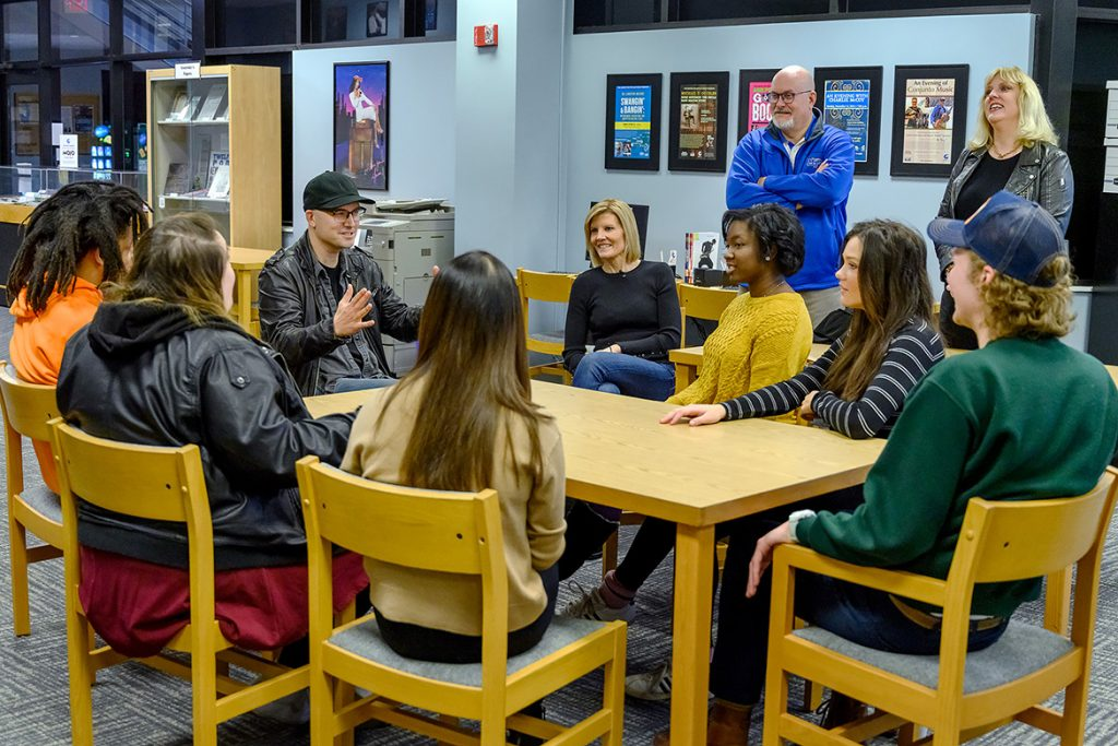 MTSU alumnus and Grammy-nominated songwriter/producer Luke Laird, left in black cap, talks to a group of MTSU recording industry students as NBC Nightly News Sunday anchor Kate Snow, center in black shirt, listens inside the Center for Popular Music in the Bragg Media and Entertainment Building in late January. Standing at right looking on are Andrew Oppmann, MTSU vice president of Marketing and Communications, and Beverly Keel, chair of the Department of Recording Industry. A segment about the recording industry department, its successful alumni and annual Grammy Awards outreach will air Sunday, Feb. 10, before the Grammys telecast on CBS. (MTSU photo by J. Intintoli)
