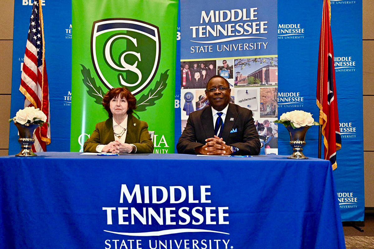Presidents Janet Smith, left, of Columbia State Community College and Sidney A. McPhee of Middle Tennessee State University talk to the audience before signing an agreement marking the MTSU Promise to Columbia State, the fifth such pathway established for students with associate degrees to move seamlessly to the four-year university. The signing occurred Feb. 6 in the MTSU Student Union Ballroom. (MTSU photo by J. Intintoli)