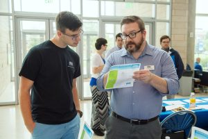 Chemistry Career Fair in the Science Building Atrium. Liija Zecevic, 21, left, an MTSU senior biochemistry major from Nashville, learns about the university's Master of Science in Professional Science Program from Carey Snowden. Photo: Andy Heidt