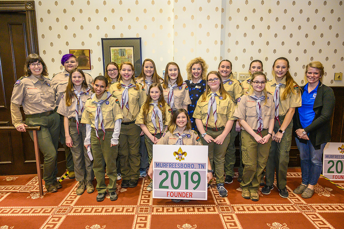 Members of Troop 2019 pose with Middle Tennessee State University employees after Friday's ceremony to welcome the new all-girl unit into Scouts BSA. (MTSU photo by Eric Sutton)