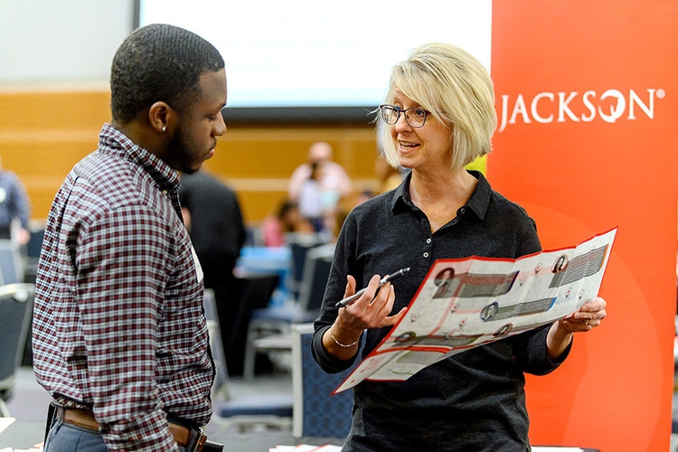 MTSU student Isaiah Brewer talks with Mona Hernandez from Jackson life insurance company during the Business Exchange for Student Talent, or BEST, Career Fair held Wednesday, March 20, in the Student Union Building ballroom. (MTSU photo by J. Intintoli)