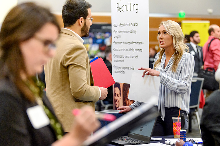 MTSU student Moe El-Assukli, left, talks with Aerotek representative Cassidy Hite during the Business Exchange for Student Talent, or BEST, Career Fair held Wednesday, March 20, in the Student Union Building ballroom. (MTSU photo by J. Intintoli)